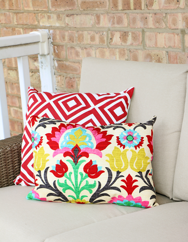 Happiness is creating: red geometric  patterned outdoor pillow and waverly santa maria fabric pillow