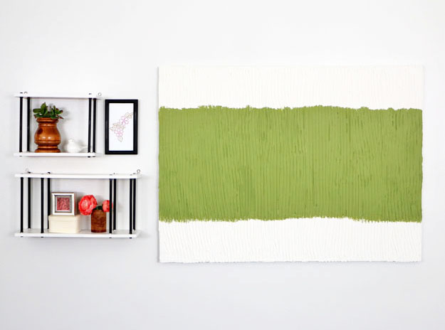 Create a textured piece of artwork with joint compound! Add a little bit of paint and you are all set!