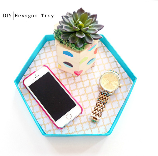 Turn a hexagon lid into a tray with some paint and decorative paper!