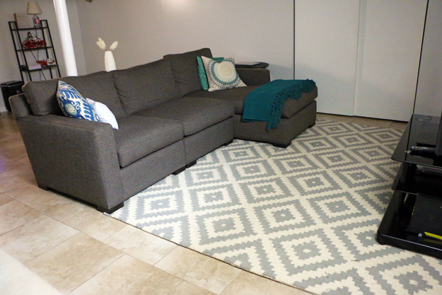 crate and barrel couch with aztec rug